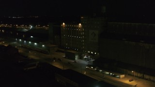 DX0002_205_021 - 5.7K stock footage aerial video orbit a flour mill at night, Buffalo, New York