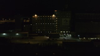 DX0002_205_022 - 5.7K stock footage aerial video of circling a flour mill at night, Buffalo, New York