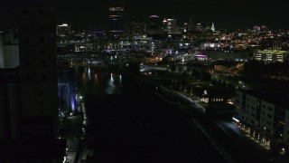 DX0002_205_024 - 5.7K stock footage aerial video of flying over the river toward the downtown skyline at night, Downtown Buffalo, New York