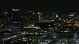 DX0002_205_027 - 5.7K stock footage aerial video of flying by skyscraper and office towers at night, Downtown Buffalo, New York
