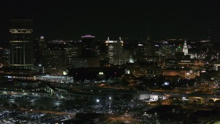 DX0002_205_028 - 5.7K stock footage aerial video of passing by a skyscraper and office towers at night, Downtown Buffalo, New York