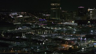 DX0002_205_032 - 5.7K stock footage aerial video of flying by parking lots near the skyscraper at night, Downtown Buffalo, New York