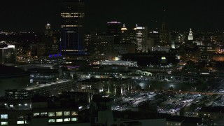 DX0002_205_033 - 5.7K stock footage aerial video of the skyline seen while passing parking lots at night, Downtown Buffalo, New York