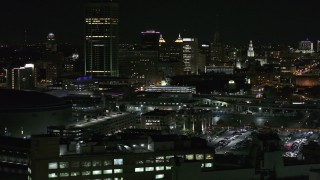 DX0002_205_034 - 5.7K stock footage aerial video of flying by the skyline seen from parking lots at night, Downtown Buffalo, New York