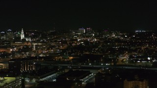DX0002_205_037 - 5.7K stock footage aerial video of a wide view of distant Buffalo General Medical Center at night, Downtown Buffalo, New York