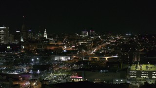 DX0002_205_038 - 5.7K stock footage aerial video of distant Buffalo General Medical Center at night, Downtown Buffalo, New York