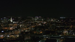 DX0002_205_040 - 5.7K stock footage aerial video of a view across downtown at distant Buffalo General Medical Center at night, Downtown Buffalo, New York