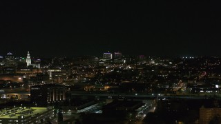 DX0002_205_041 - 5.7K stock footage aerial video of distant Buffalo General Medical Center at night during descent, Downtown Buffalo, New York