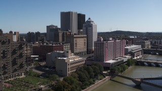 DX0002_206_001 - 5.7K stock footage aerial video approach riverfront hotels and the city's skyline, Downtown Rochester, New York