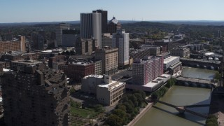 DX0002_206_003 - 5.7K stock footage aerial video a stationary view of riverfront hotels and the city's skyline, Downtown Rochester, New York