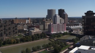 DX0002_206_005 - 5.7K stock footage aerial video of riverfront hotels and the city's skyline across the river, Downtown Rochester, New York