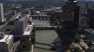 DX0002_206_010 - 5.7K stock footage aerial video fly away from riverfront hotel across from office building, Downtown Rochester, New York