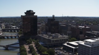 DX0002_206_018 - 5.7K stock footage aerial video orbit riverfront office towers and hotel, Downtown Rochester, New York