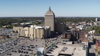 DX0002_206_020 - 5.7K stock footage aerial video focus on Kodak Tower and Monroe Community College during descent, Rochester, New York