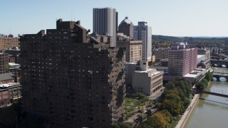 DX0002_206_024 - 5.7K stock footage aerial video orbit riverfront apartment complex and reveal river, Downtown Rochester, New York