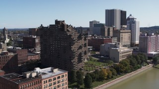 DX0002_206_025 - 5.7K stock footage aerial video orbit riverfront apartment complex overlooking the river, Downtown Rochester, New York