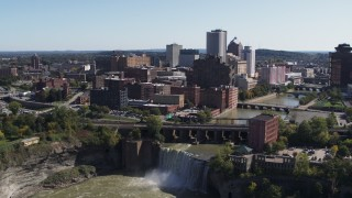 DX0002_206_029 - 5.7K stock footage aerial video fly away from the city's skyline to reveal waterfalls on the river, Downtown Rochester, New York