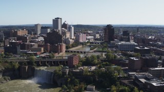 DX0002_206_037 - 5.7K stock footage aerial video fly away from bridges and High Falls for view of skyline, Downtown Rochester, New York