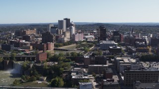 DX0002_206_038 - 5.7K stock footage aerial video a wide view of High Falls, Genesee River and skyline, Downtown Rochester, New York