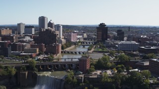 DX0002_206_040 - 5.7K stock footage aerial video of flying over High Falls toward Genesee River bridges and skyline, Downtown Rochester, New York
