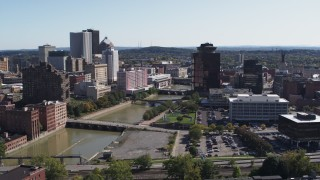 DX0002_206_041 - 5.7K stock footage aerial video of passing Genesee River bridges and office tower, Downtown Rochester, New York