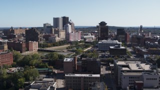 DX0002_206_042 - 5.7K stock footage aerial video descend while focused on skyline and office tower, Downtown Rochester, New York