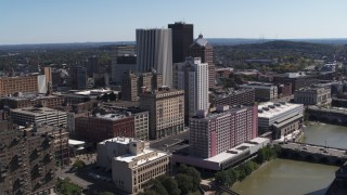 DX0002_206_044 - 5.7K stock footage aerial video of skyline and river seen while ascending by apartment complex, Downtown Rochester, New York