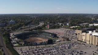 DX0002_206_045 - 5.7K stock footage aerial video fly away from Frontier Field to reveal Monroe Community College, Rochester, New York