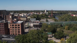DX0002_206_046 - 5.7K stock footage aerial video smoke stack and bridges spanning the river, Rochester, New York