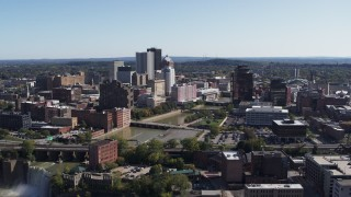 DX0002_207_006 - 5.7K stock footage aerial video reverse view of river bridges and skyline, reveal the waterfall, Downtown Rochester, New York