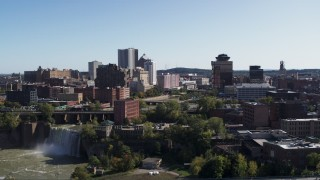 DX0002_207_009 - 5.7K stock footage aerial video focus on skyline while flying past High Falls, Downtown Rochester, New York