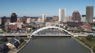 DX0002_207_010 - 5.7K stock footage aerial video a reverse view of the skyline behind bridge, Downtown Rochester, New York