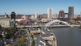 DX0002_207_011 - 5.7K stock footage aerial video of the skyline behind bridge over Genesee River, Downtown Rochester, New York