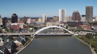 DX0002_207_012 - 5.7K stock footage aerial video slowing approach bridge over Genesee River near skyline, Downtown Rochester, New York