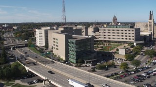 DX0002_207_014 - 5.7K stock footage aerial video of the police station during descent, Downtown Rochester, New York