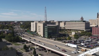 DX0002_207_017 - 5.7K stock footage aerial video flying toward the police station by I-490, Downtown Rochester, New York