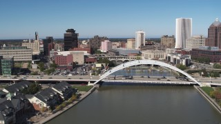 DX0002_207_018 - 5.7K stock footage aerial video fly away from bridges over Genesee River in Downtown Rochester, New York