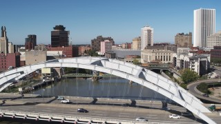 DX0002_207_020 - 5.7K stock footage aerial video fly over Douglass-Anthony Bridge to reveal more bridges over Genesee River in Downtown Rochester, New York