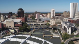 DX0002_207_021 - 5.7K stock footage aerial video fly away from bridges to reveal Douglass-Anthony Bridge in Downtown Rochester, New York