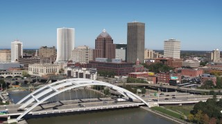 DX0002_207_022 - 5.7K stock footage aerial video fly away from skyline to reveal Douglass-Anthony Bridge in Downtown Rochester, New York
