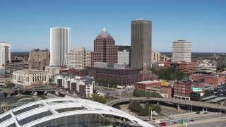 DX0002_207_024 - 5.7K stock footage aerial video reverse view of the skyline and reveal Douglass-Anthony Bridge, Downtown Rochester, New York