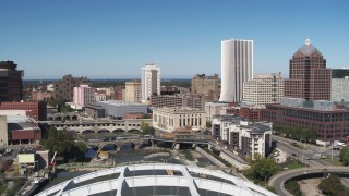 DX0002_207_027 - 5.7K stock footage aerial video of bridges spanning Genesee River and The Metropolitan skyscraper, Downtown Rochester, New York