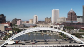 DX0002_207_029 - 5.7K stock footage aerial video focus on high-rises while passing Douglass-Anthony Bridge, Downtown Rochester, New York