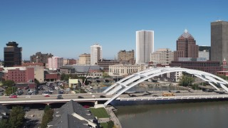 DX0002_207_030 - 5.7K stock footage aerial video focus on skyline while flying away from Douglass-Anthony Bridge, Downtown Rochester, New York