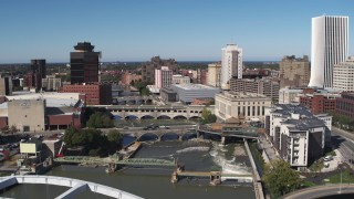 DX0002_207_033 - 5.7K stock footage aerial video of passing bridges over the river and city buildings, Downtown Rochester, New York