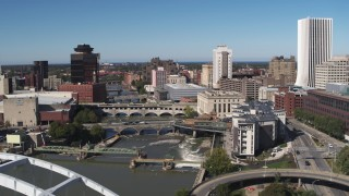 DX0002_207_036 - 5.7K stock footage aerial video ascend past traffic on the Douglass-Anthony Bridge for view of river and Downtown Rochester, New York