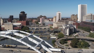 DX0002_207_037 - 5.7K stock footage aerial video flyby and descend near the Douglass-Anthony Bridge with view of river and Downtown Rochester, New York