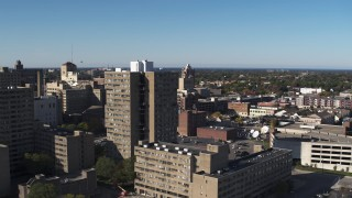 DX0002_208_004 - 5.7K stock footage aerial video fly away from an apartment complex in Downtown Rochester, New York