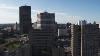 DX0002_208_006 - 5.7K stock footage aerial video of Five Star Bank Plaza behind apartment building in Downtown Rochester, New York