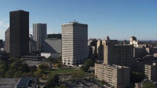 DX0002_208_008 - 5.7K stock footage aerial video focus on Five Star Bank Plaza, flyby apartment complex in Downtown Rochester, New York